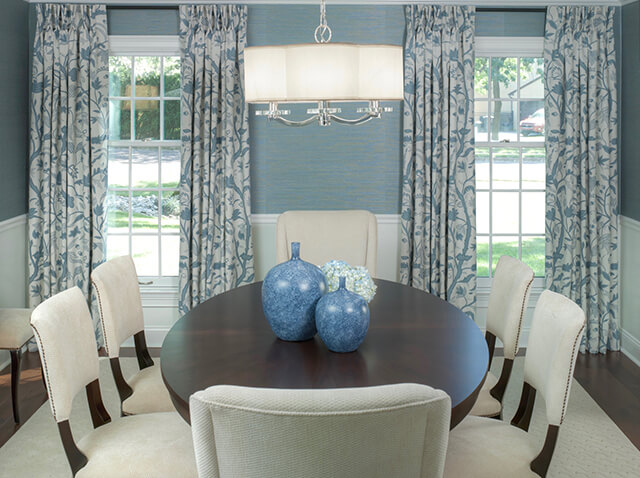 Oval table with blue vases