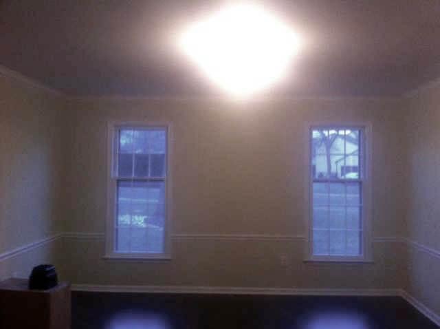 Dark empty kitchen wall