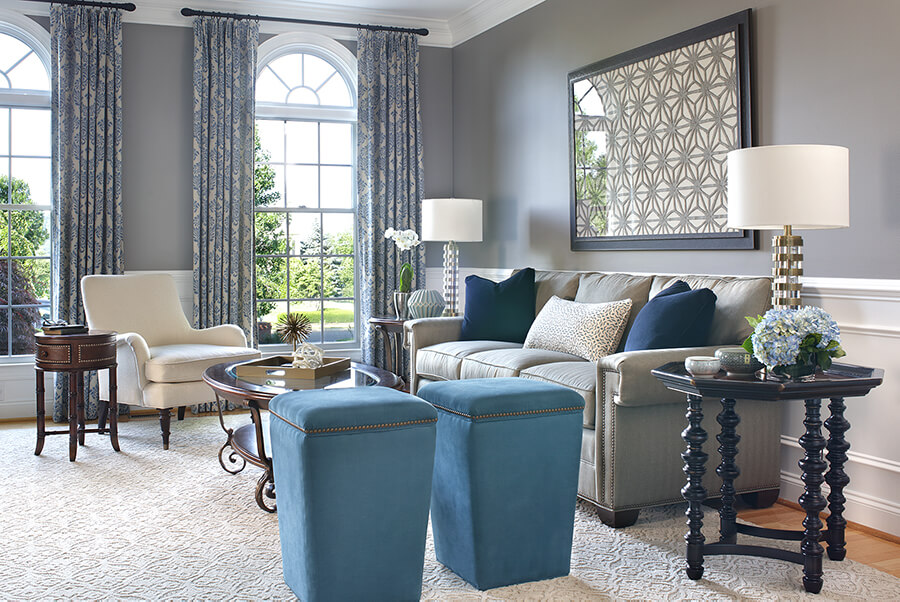 Bright window with blue patterned drapes