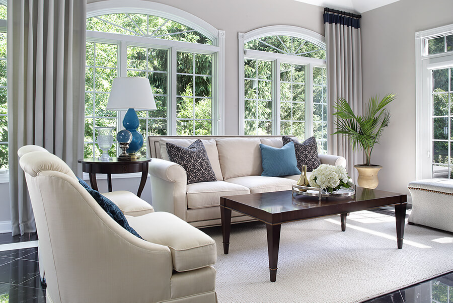 Windows with creme drapes with black band at top