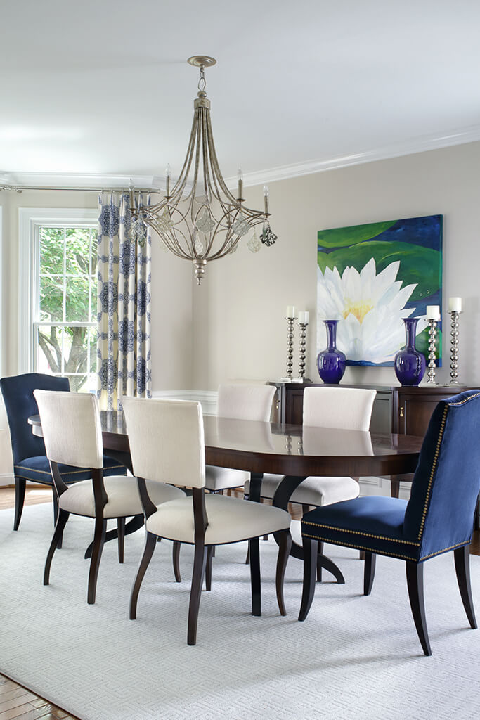 Kitchen table with purple chairs and purple vases
